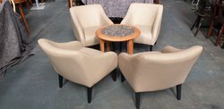 Cream arm chairs in leather