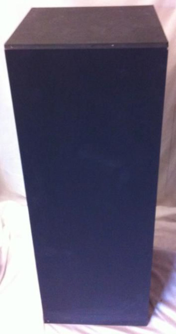 Tall black exhibition or display plinths