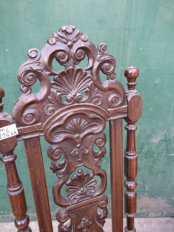 A beautifully carved pair of Carolean chairs.