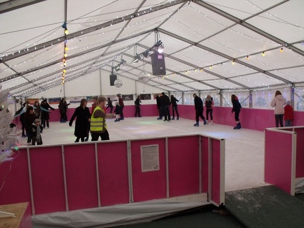 Buy all the equipment to build and run an ice rink