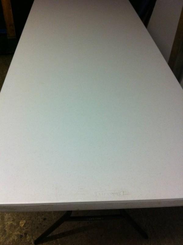 Plastic white trestle table folding legs